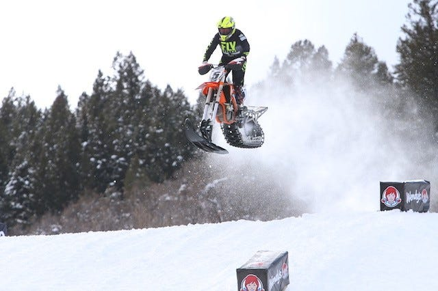 Mike Schultz of St. Cloud maneuvers through the Snow Bike course during the X Games this weekend in Aspen, Colorado. Schultz won gold in the event.