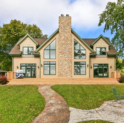 Mansion on the market: Green Lake home offers warmth, waterfront views