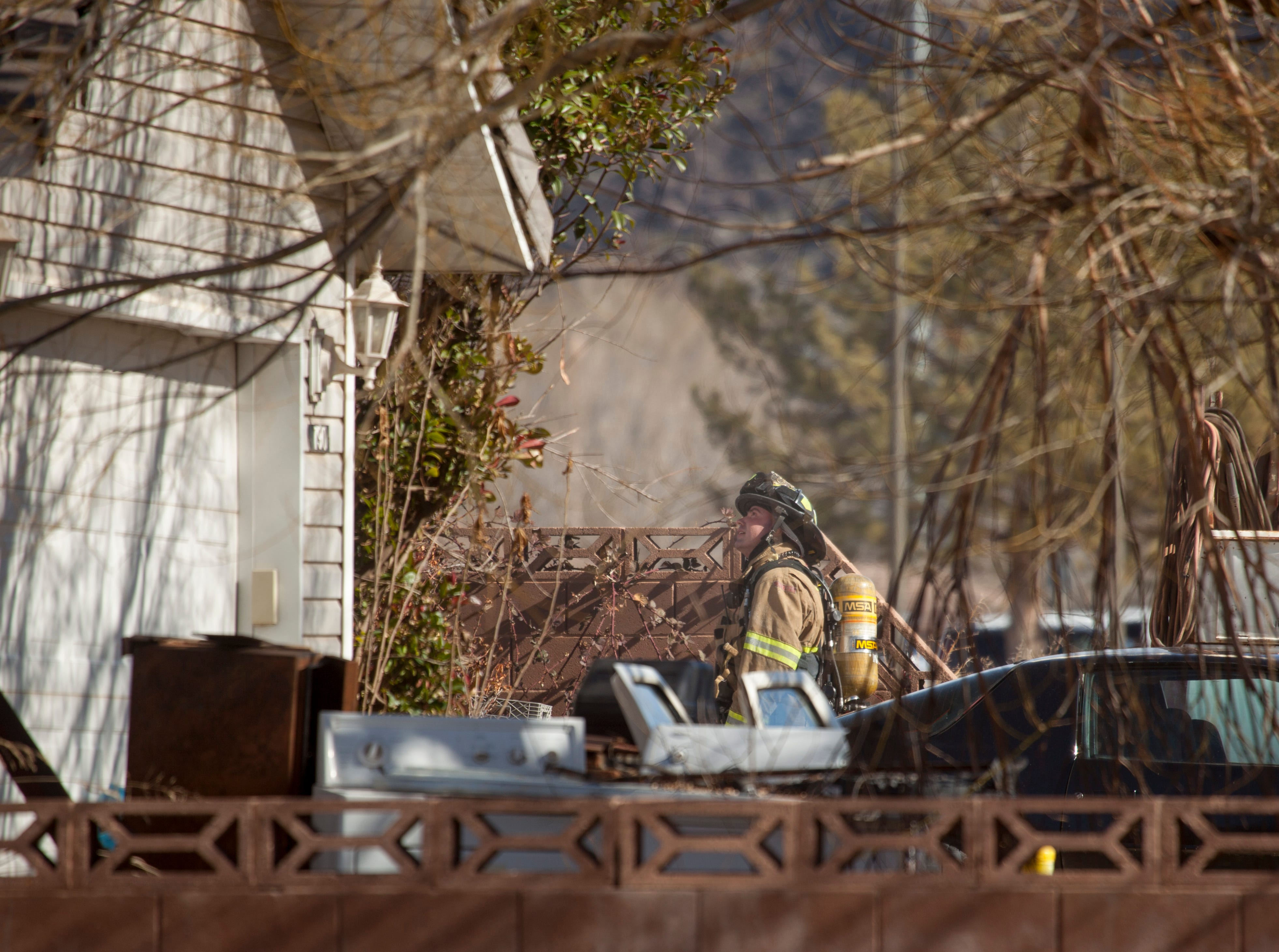Fire crews respond to a house fire in Hurricane Monday, Jan. 28, 2019.