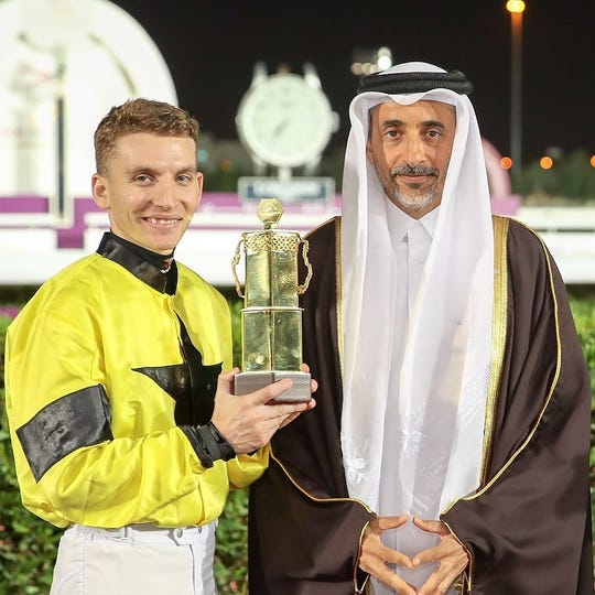 Ryan Curatolo receives his trophy after winning the Qatar Derby.