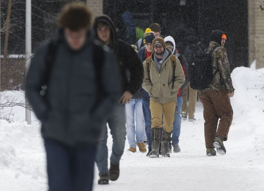 UWSP students walk between classes on campus on Monday, Jan. 28, 2019, in Stevens Point, Wis. A winter storm rolled through Wisconsin on Sunday and Monday, marking the first major snowfall of the season.