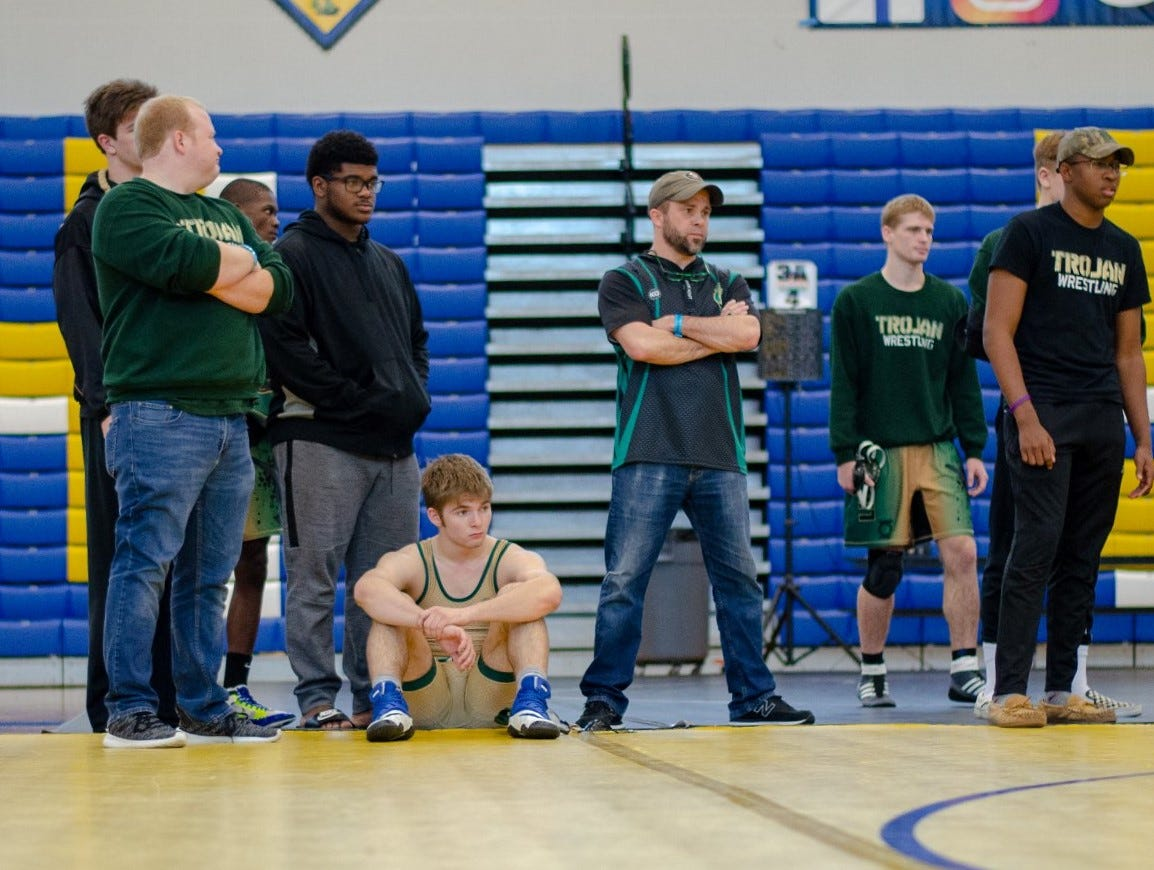 Lincoln's Eli Crum and coach Mike Crowder look on as the Trojans' wrestling team finished in the state semifinals at the FHSAA Wrestling Dual State Championships in Kissimmee.