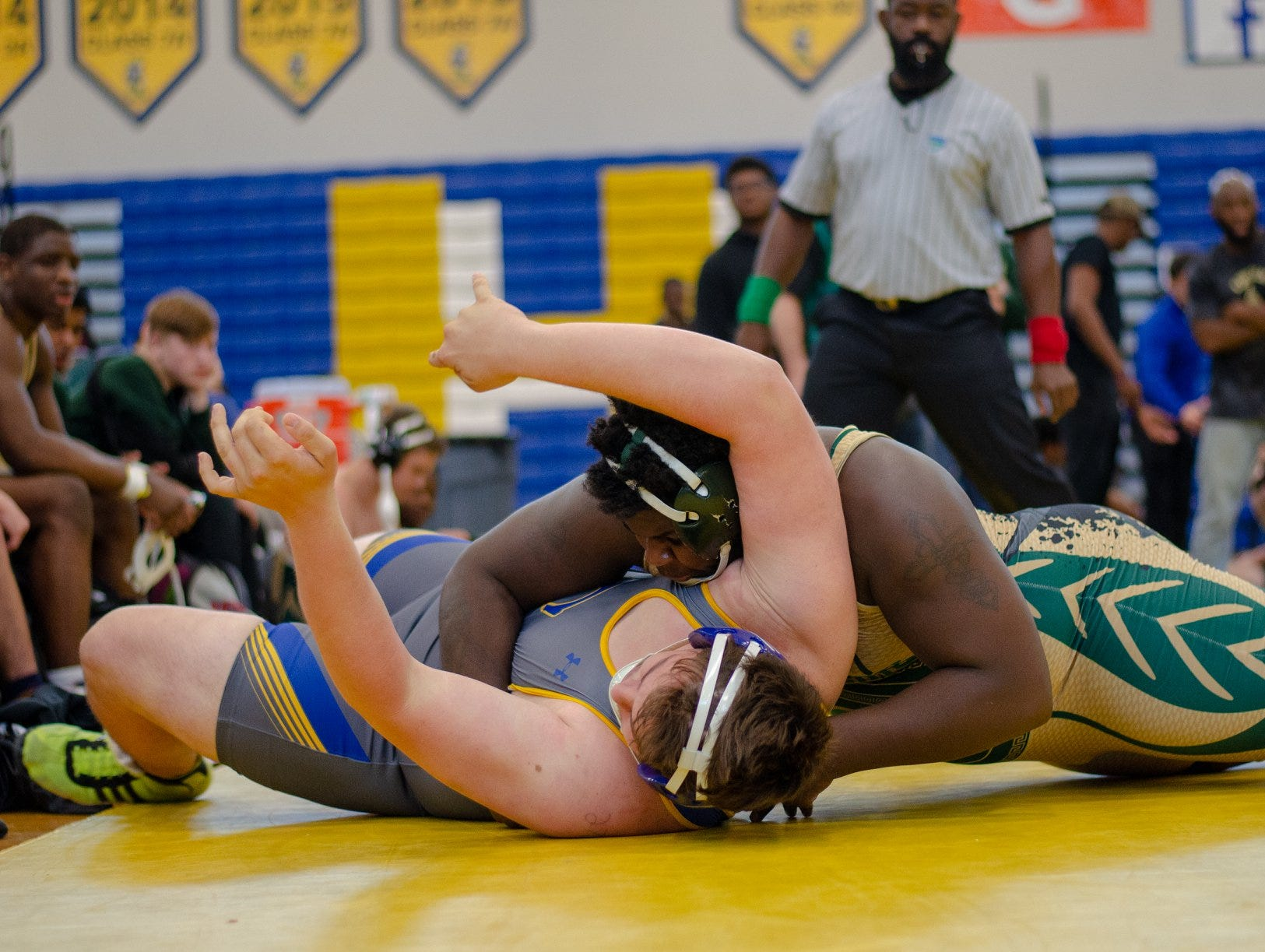 Lincoln's J.T. Rivers takes down his opponent as Lincoln's wrestling team finished in the state semifinals at the FHSAA Wrestling Dual State Championships in Kissimmee.