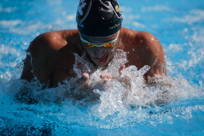 Florida State University's Paxton Rhoads swims the men's 100 yard backstroke at a meet with Florida Atlantic University at the Morcom Aquatic Center in Tallahassee Saturday, Jan. 26, 2019.
