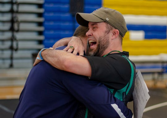 Lincoln wrestling coach Mike Crowder hugs Wakulla wrestling coach Will Pafford after Wakulla wrestling beat Lemon Bay on Saturday in Kissimmee, advancing to the state championship match of the FHSAA Wrestling Dual State Championships. The War Eagles finished as state runner-up, the first time an area team has finished with a state trophy.