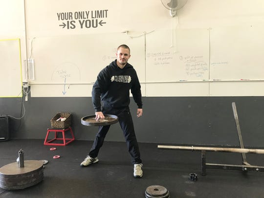 Nigel Blackburn shows off the hub lift with a 45-pound plate. The Tallahassee native will compete in the World ArmliftingChampionship in St. Petersberg, Russia. The title event takes place May 11-12.