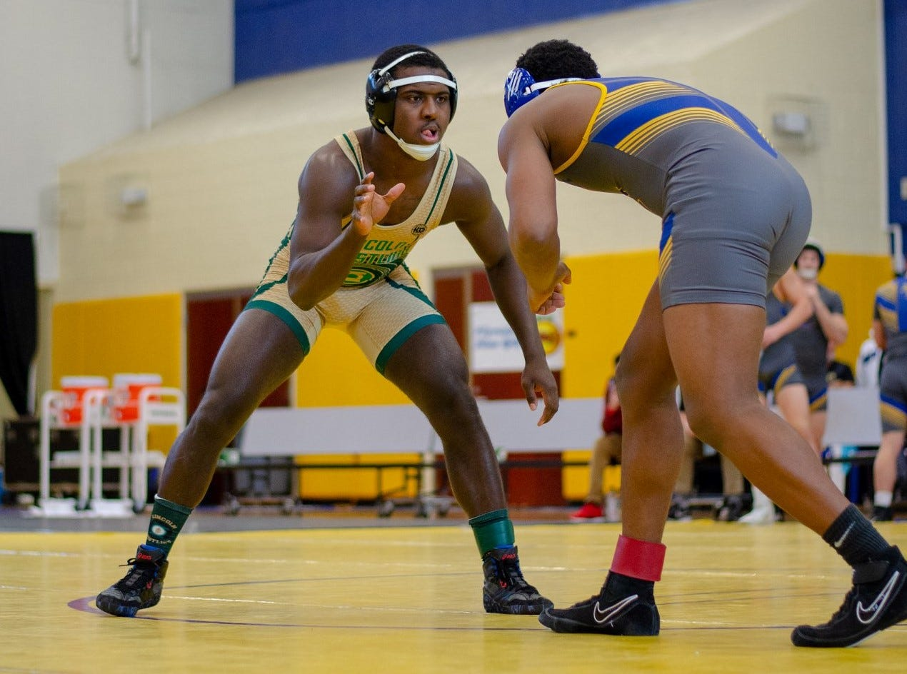 Lincoln's Tony Davis wrestles as the Trojans' wrestling team finished in the state semifinals at the FHSAA Wrestling Dual State Championships in Kissimmee.