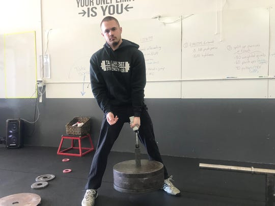 Nigel Blackburn practices the loadable vertical lift set at 185 pounds.