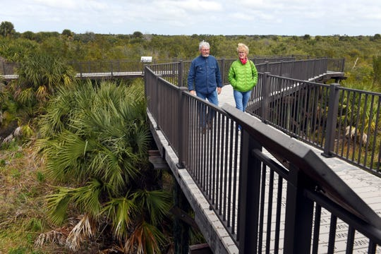 Reed and Mary Jane DeVault, of Winter Park, walk along the boardwalk of the Centennial Trail on Monday, Jan. 28, 2019 at Pelican Island National Wildlife Refuge in Indian River County. Monday was the first day refuge staff were able to come back to work after the 35-day federal government shutdown, the longest in U.S. history.