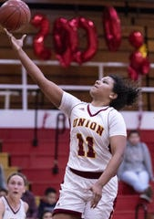 Tulare Union's Kiara Brown shoots against Monache in a girls basketball game on Tuesday, January 22, 2019. She passed the 2,000 point mark in her career during the first quarter.