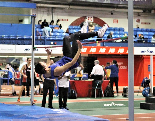 Hen Hud's Eli Aaronson clears a personal-best 6-4.5 to win the 2019 Westchester boys high jump. The jump qualified him for New Balance Indoor Nationals.