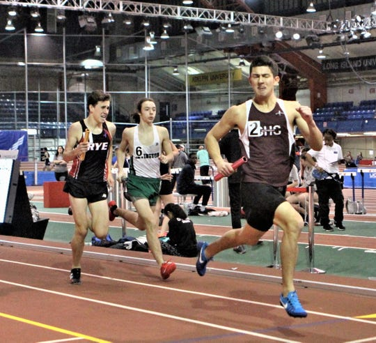 Scarsdale's Nico Bernard wins the race to the finish to give Scarsdale the 2019 Westchester boys 4x800 relay title.