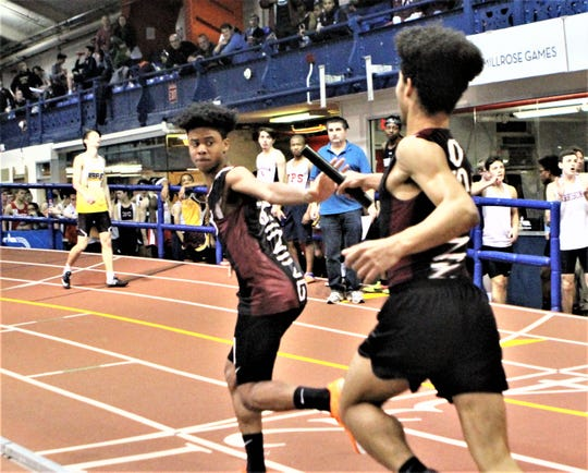 Ossining's Joshua Harley takes the baton from Thomas Petluck during the 2019 Westchester boys indoor 4x200 relay championship. Ossining won in 1:31.75.