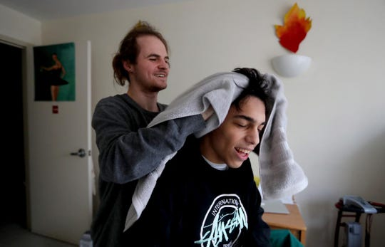 Nick Astor, a freshman at Purchase College, gets his hair towel dried Jan. 25, 2019 by Dawson Goodrich, one of the student aides that assists Nick, who has cerebral palsy. Nick also has a live in aide who lives in the dorm room next to his. A change in Gov. Cuomo's budget may now make it more difficult for Nick to continue to get the round the clock care that he needs  in order to be able to live on campus while attending college.