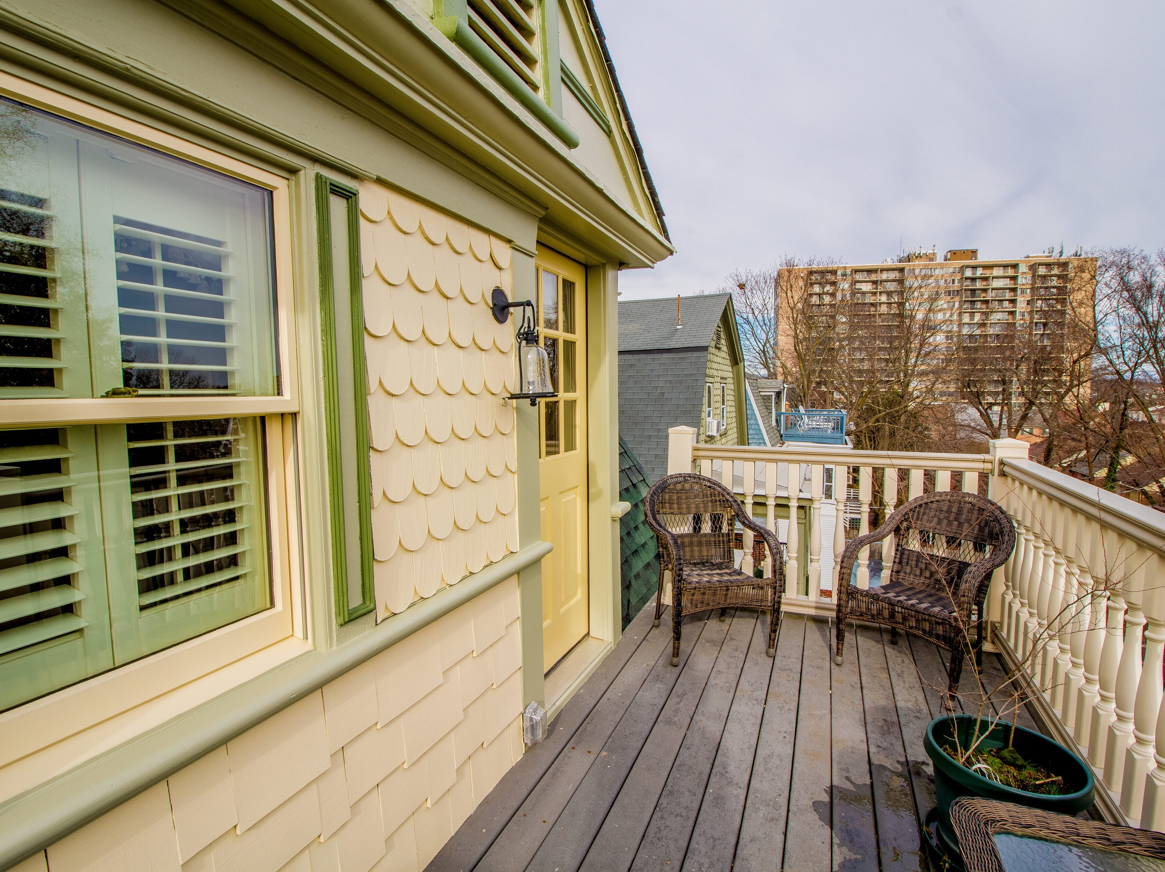 A deck offers escape off the third-floor guest room in the house at 1100 North Rodney in Cool Spring.