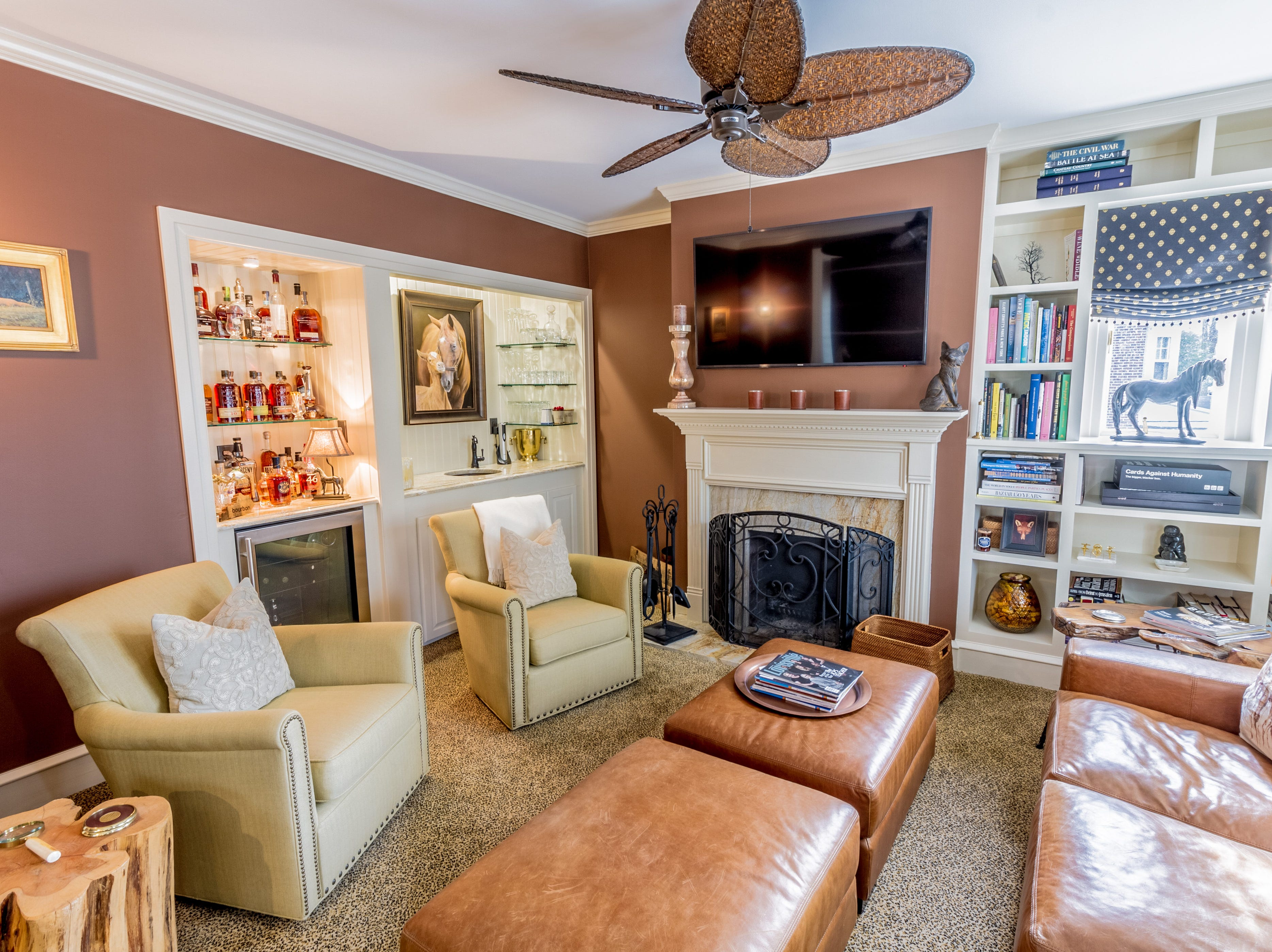 The family room in 1100 N. Rodney St.  has a fireplace, bar and wine fridge and is decorated in a bourbon theme that honors the owner's Kentucky roots.