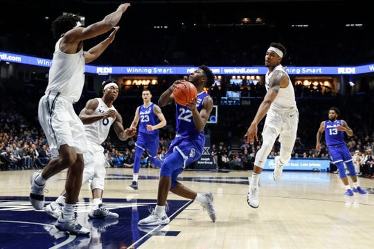 Seton Hall's Myles Cale (22) drives to the net during the second half of an NCAA college basketball game against Xavier, Wednesday, Jan. 2, 2019, in Cincinnati.