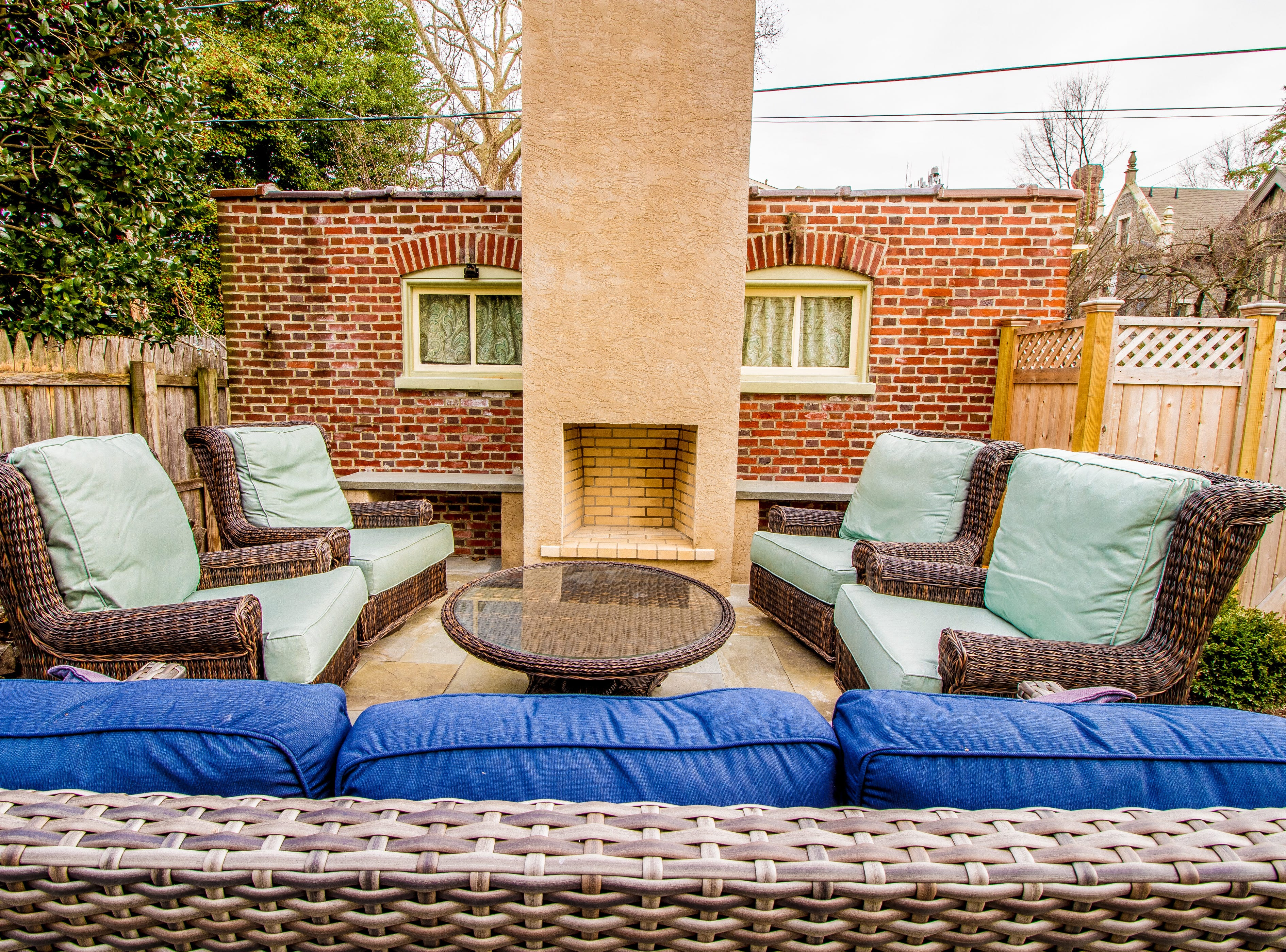 The backyard at the house at 1100 N. Rodney St. is fenced for privacy and has a fireplace and fountain.