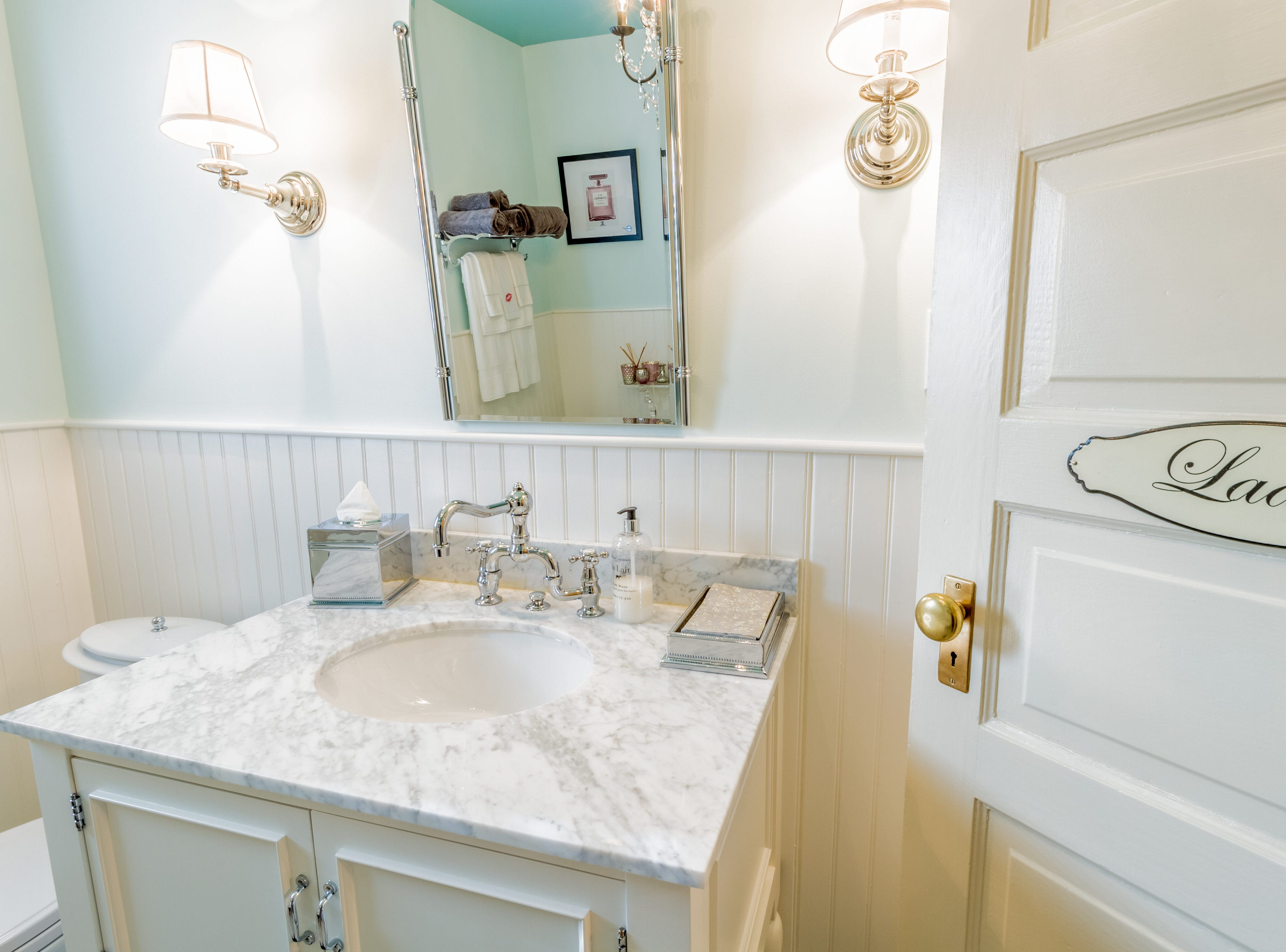 The hall bath at 1100 N. Rodney St. has a clawfoot tub and a marble-topped vanity.