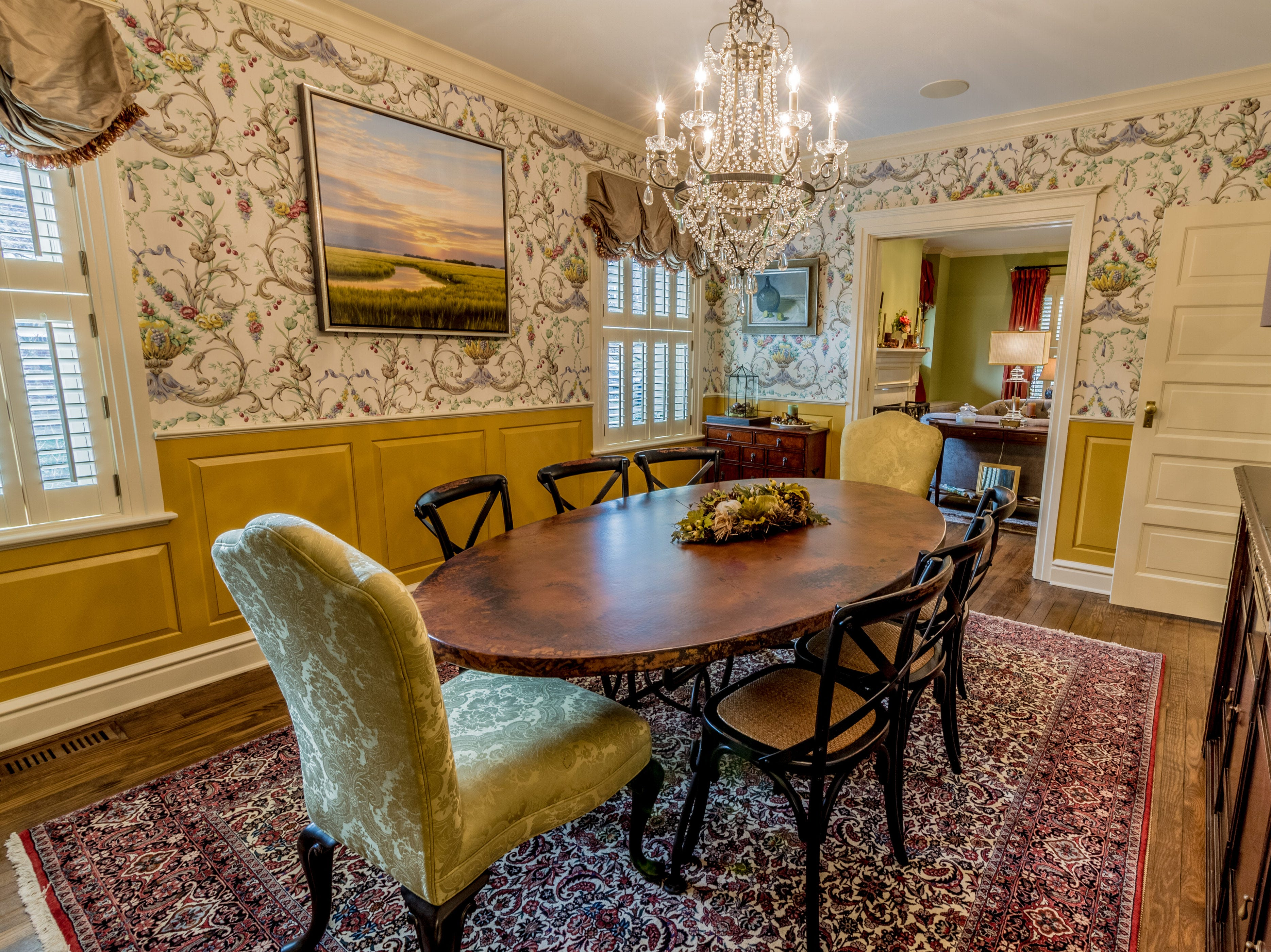 Moldings and a chair rail grace the formal dining room at 1100 North Rodney St. in Cool Spring.