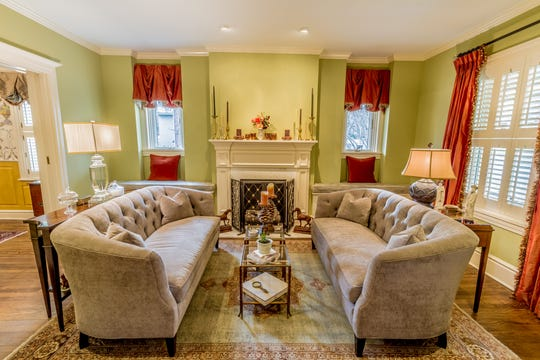 A fireplace acts as a focal point in the  formal parlor in 1100 North Rodney Street.