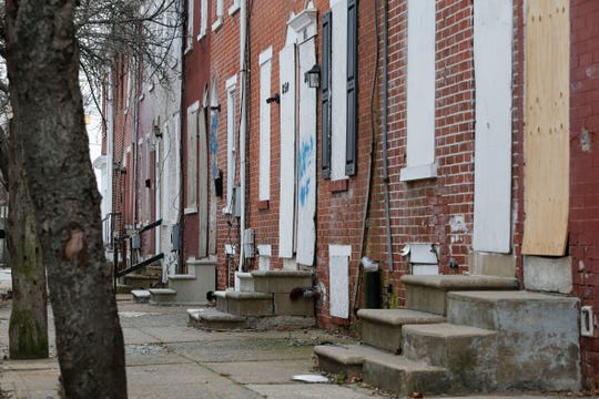 Boarded up houses on the 800 block of Bennett Street in Wilmington owned by the Wilmington Housing Partnership are now the responsibility of the city.