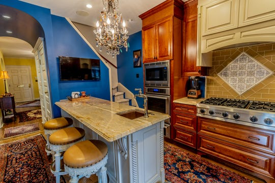 The kitchen at 1100 North Rodney is outfitted with quartzite counters, a farmhouse sink and professional-style appliances.