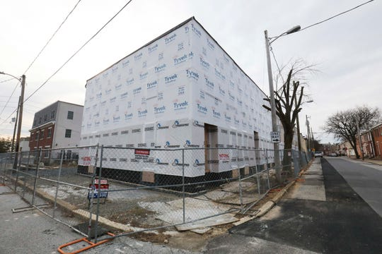 A Wilmington Housing Partnership project on Bennett Street between Taylor and East 8th Streets sits incomplete.