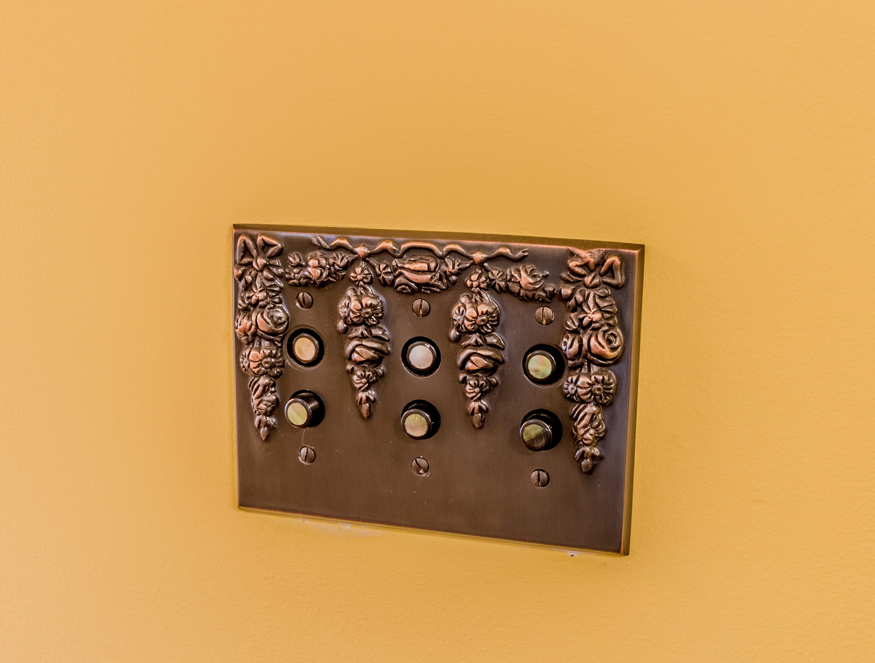Reproduction light switches contribute to the vintage vibe in the house at 1100 North Rodney St.