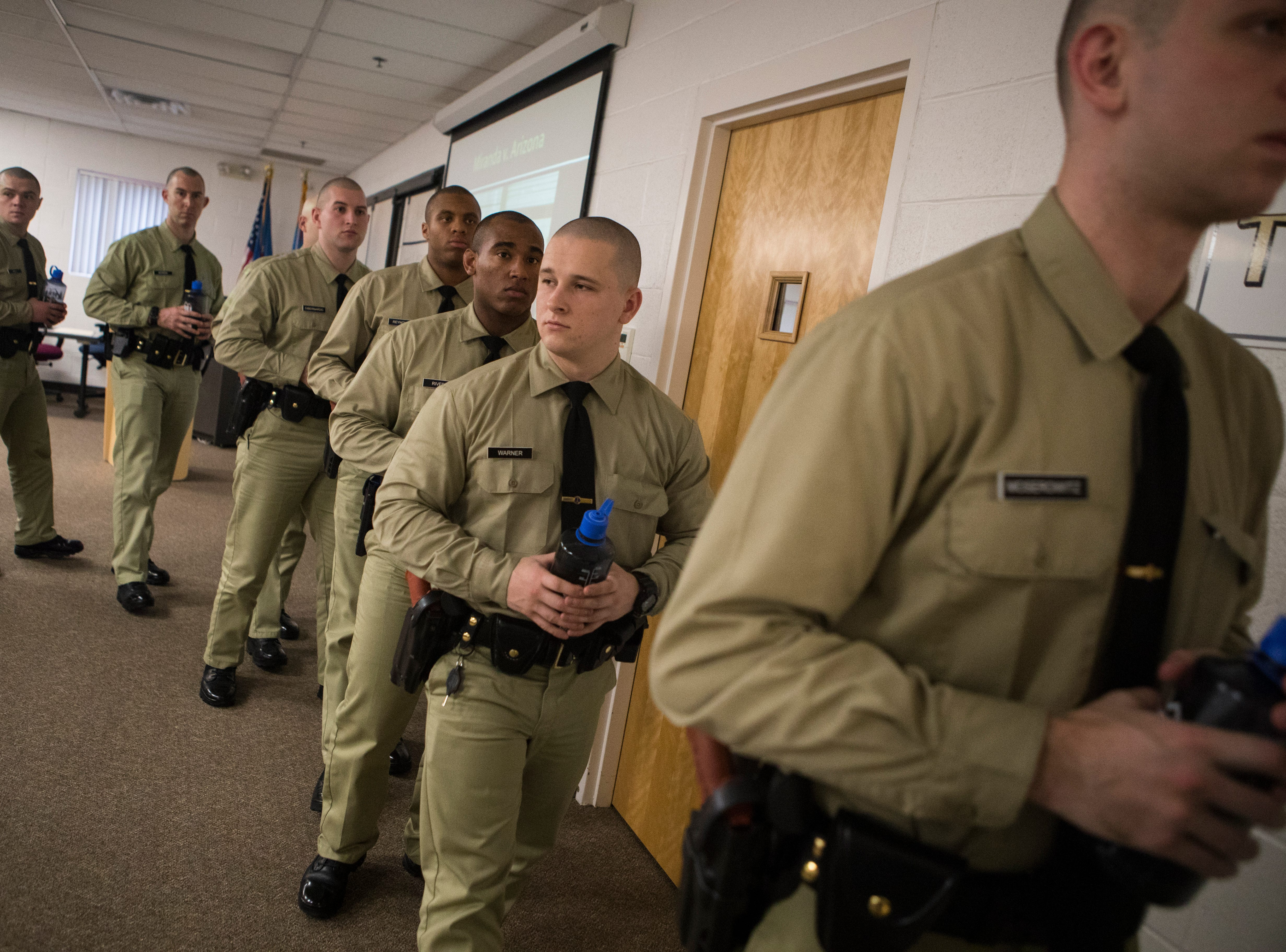 Recruits in the New Castle County Police Academy head towards the gym for physical training during a break from classroom instruction Thursday, Jan. 24, 2019 at the Lieutenant Joseph L. Szczerba Police Academy.