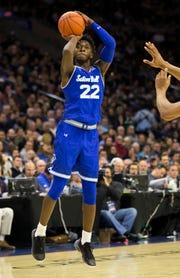 Seton Hall's Myles Cale shoots a three-point basket during the second half of an NCAA college basketball game against Villanova, Sunday, Jan. 27, 2019, in Philadelphia. (AP Photo/Chris Szagola)