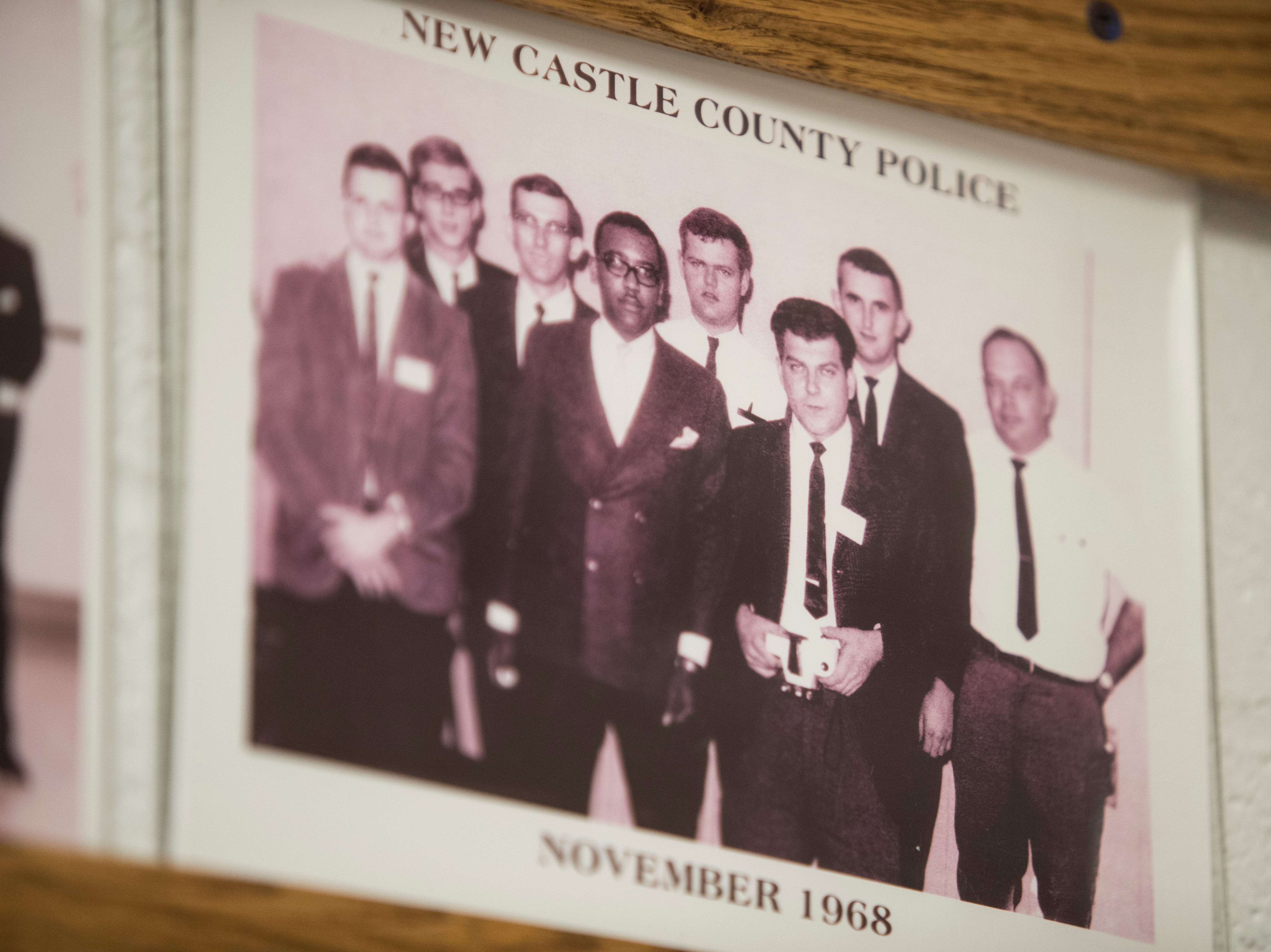 Photographs of past recruiting classes at the New Castle County Police Academy hang on the walls at the Lieutenant Joseph L. Szczerba Police Academy.