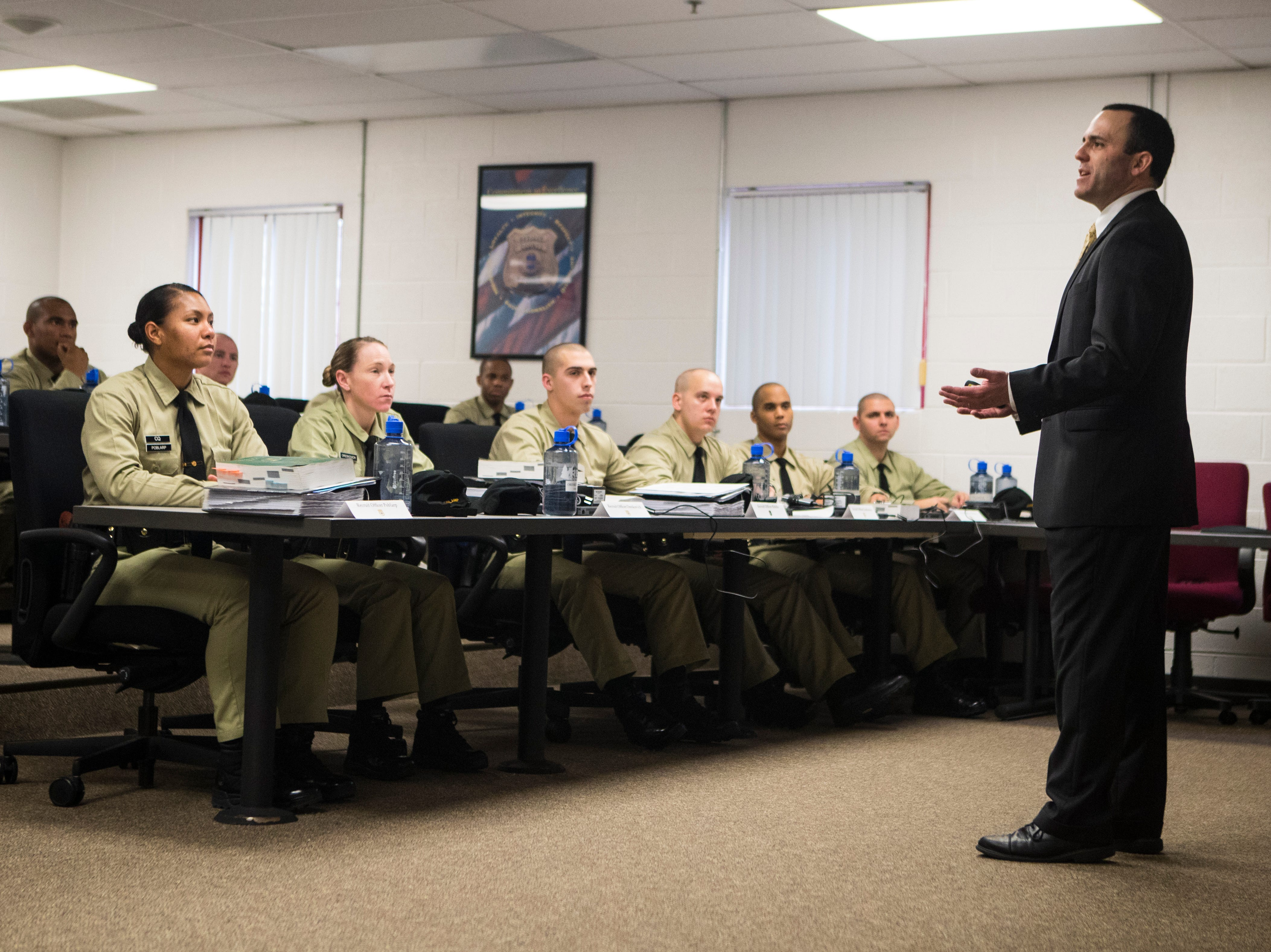 Recruits in the the New Castle County Police Academy listen to instruction from Lieutenant Andrew Rubin of the Newark Police Department during a classroom session Thursday, Jan. 24, 2019 at the Lieutenant Joseph L. Szczerba Police Academy.