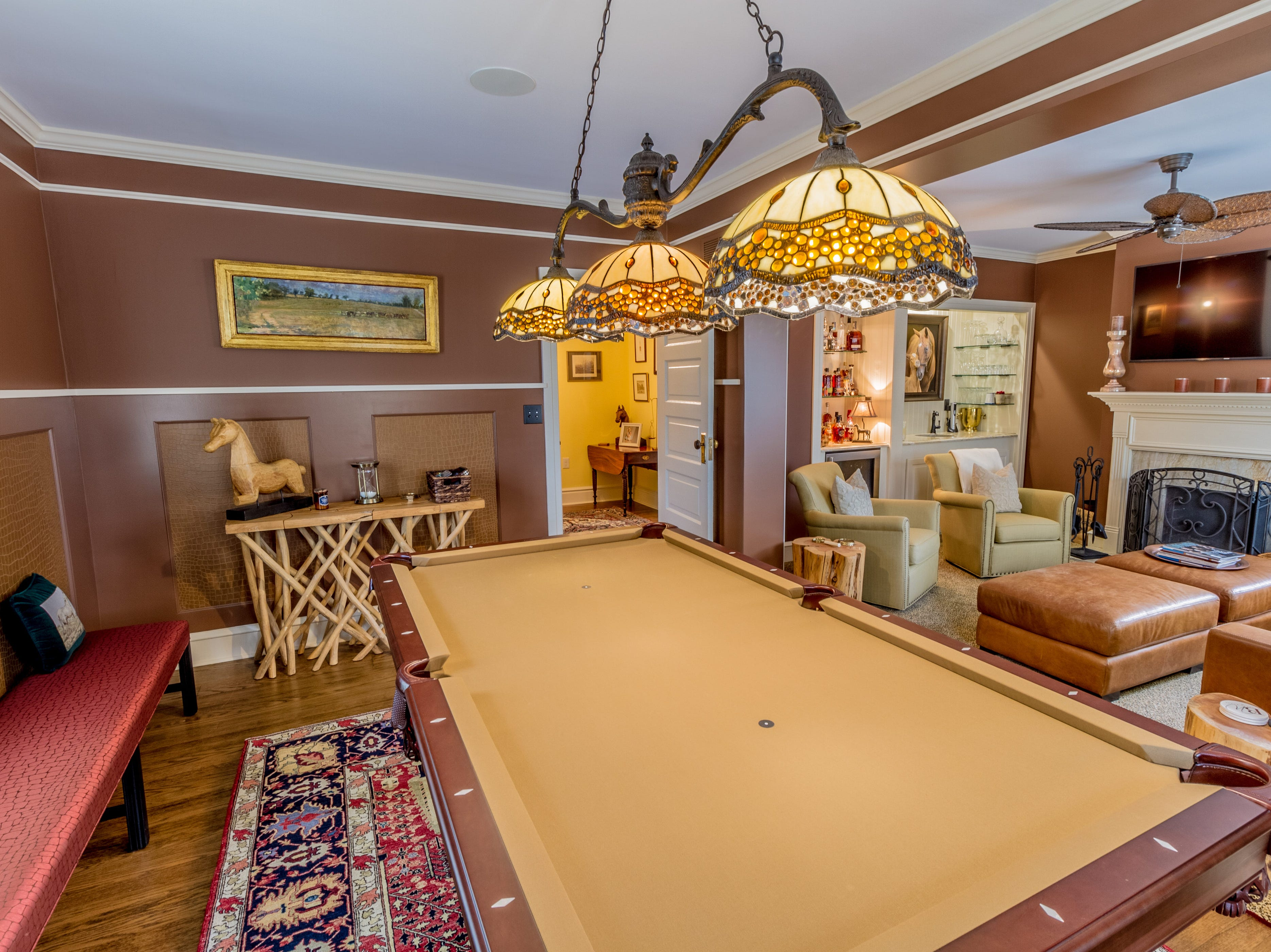 A billiards room adjoins the second-floor family room in the house at 1100 N. Rodney St. in Cool Spring.