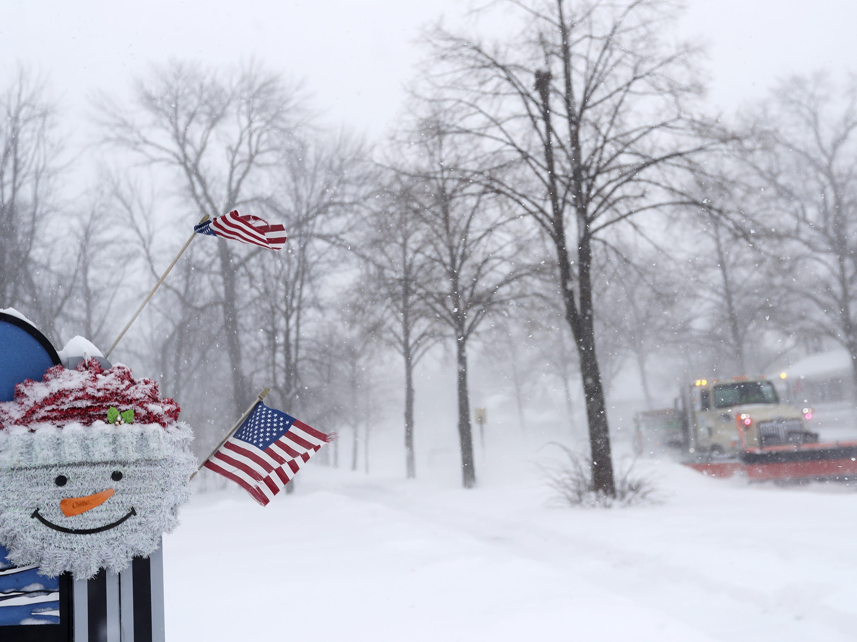 City snow plows clear streets during a snowstorm on Monday, Jan. 28, 2019 in Green Bay, Wis.