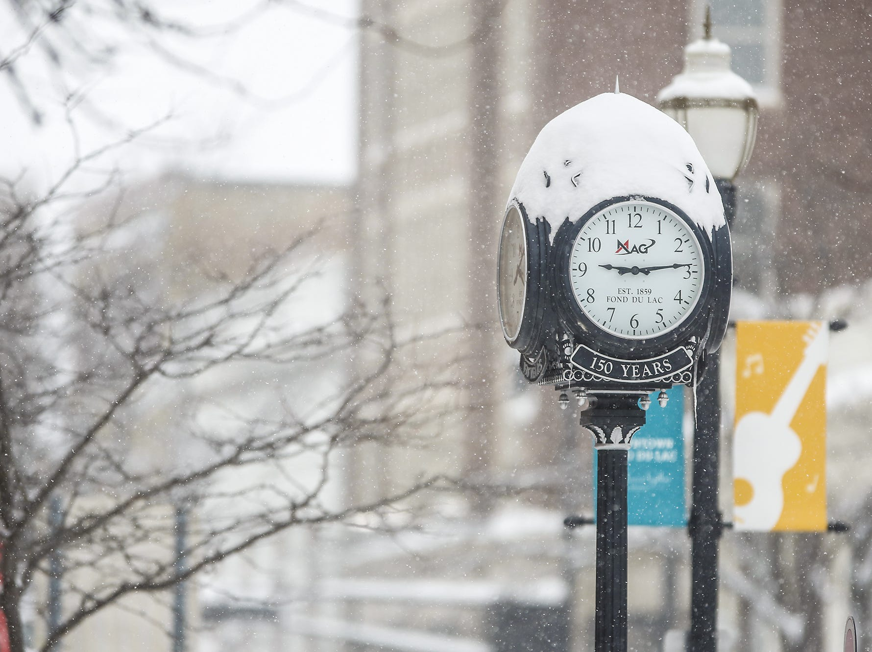 Snow falls Monday, Jan. 28, 2019, in downtown Fond dulac during a snow storm that hampered travel and closed businesses and schools in the Fond du Lac area. This was the Fond du Lac area's second snow storm in five days.