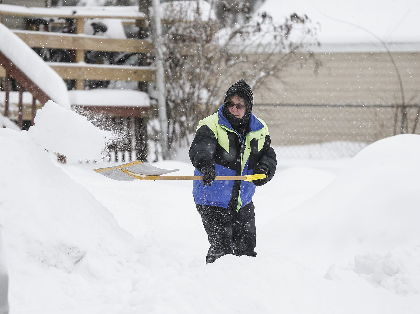 Sue Gerritson shovels out her driveway Monday, Jan. 28, 2019, on Seymour Street in Fond du Lac, Wisconsin during a snow storm that hampered travel and closed businesses and schools in the Fond du Lac area. This was the Fond du Lac area's second snow storm in five days.