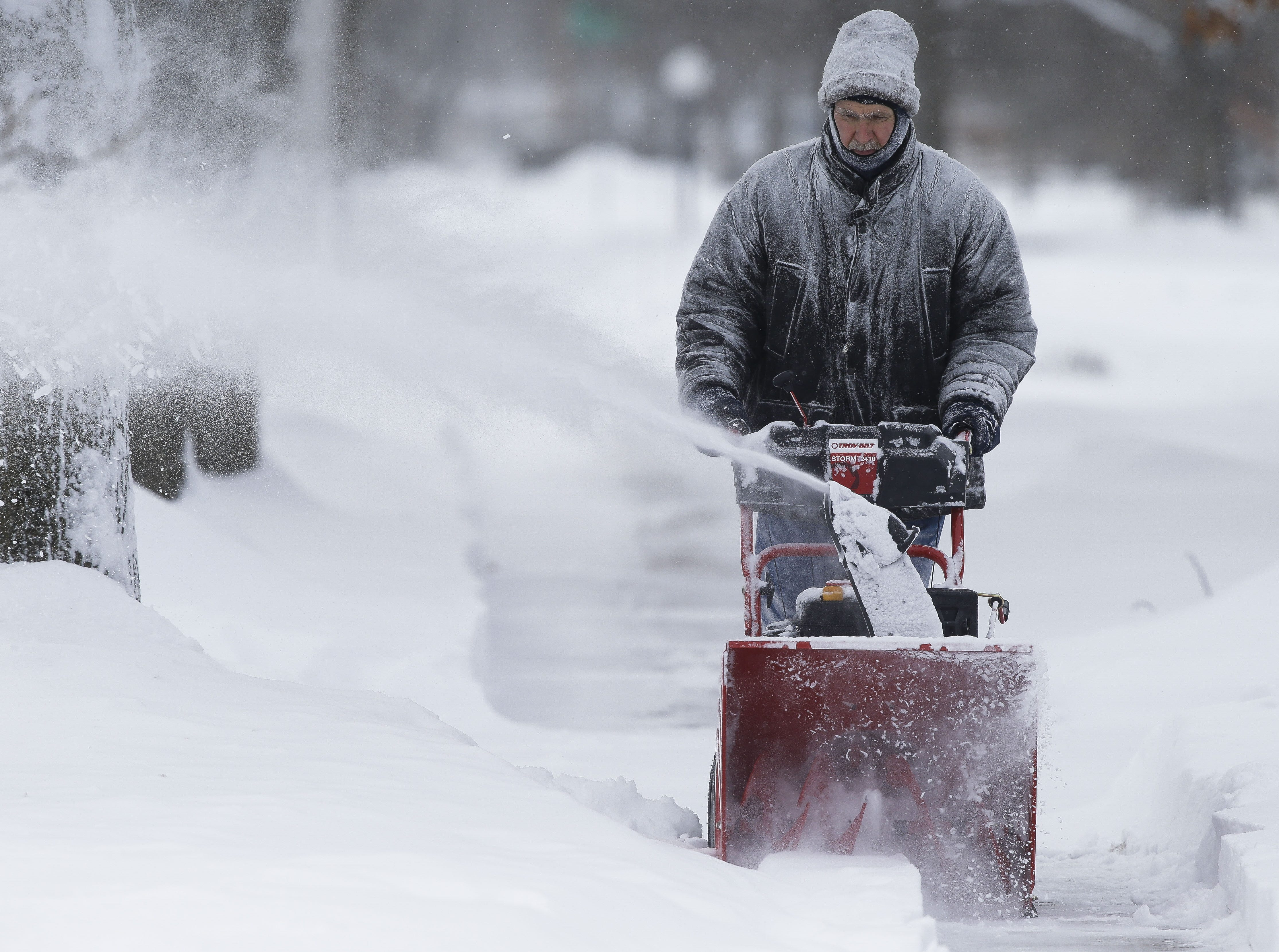 Roy Cychosz clears the sidewalk in front of his home on Monday, Jan. 28, 2019, in Stevens Point, Wis. A winter storm rolled through Wisconsin on Sunday and Monday, marking the first major snowfall of the season.