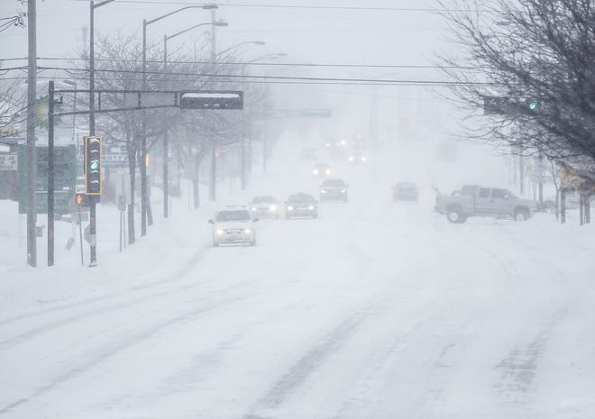 Cars travel Monday, Jan. 28, 2019, on east Johnson Street in Fond du lac, Wisconsin during a snow storm that hampered travel and closed businesses and schools in the Fond du Lac area. This was the Fond du Lac area's second snow storm in five days.