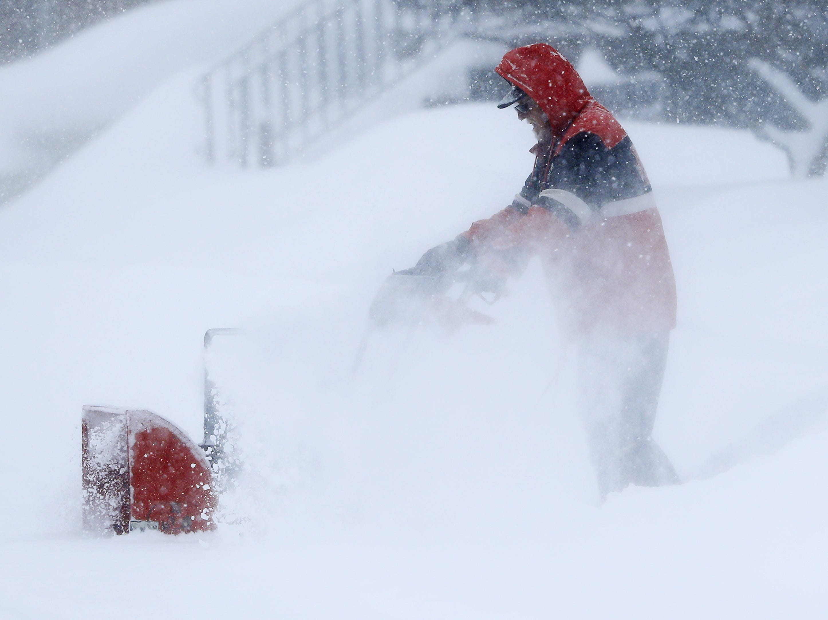 A man uses a snowblower during a snowstorm on Monday, Jan. 28, 2019, in Green Bay, Wis.