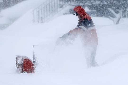 A man uses a snowblower Jan. 28 in Green Bay. The city got hit with almost 10 inches of snow that day. The frequent snowfalls in January and February have led to a high number of citations issued to residents for not shoveling their sidewalks.