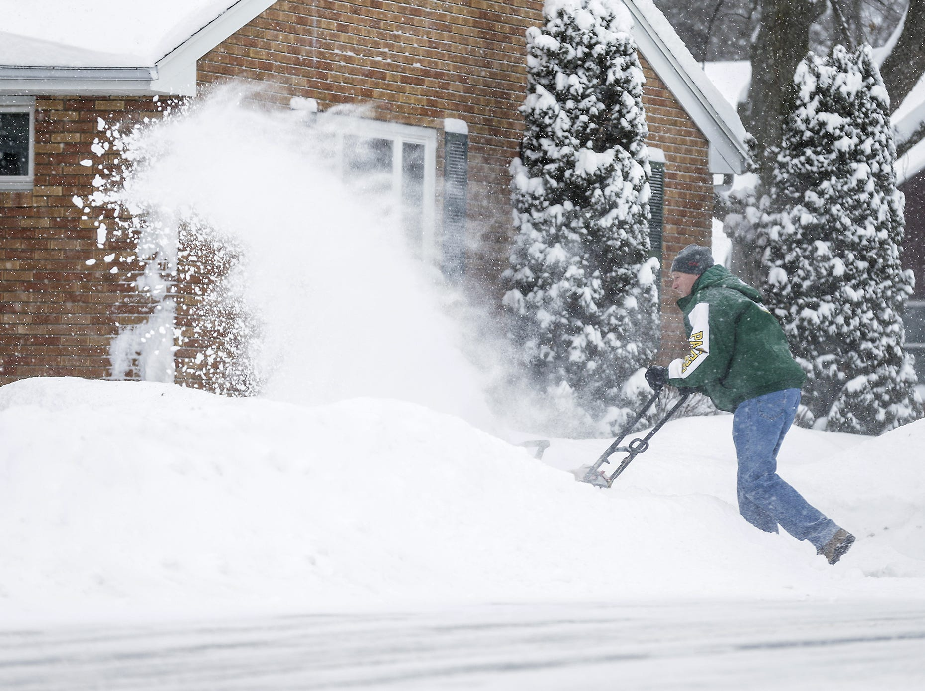 Jeff Fischer of Fond du Lac, snowblows his driveway Monday, Jan. 28, 2019, during a snow storm that hampered travel and closed businesses and schools in the Fond du Lac area. This was the Fond du Lac area's second snow storm in five days.