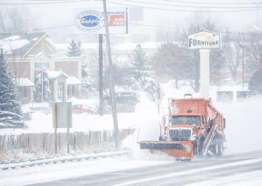A snow plow clears snow Monday, Jan. 28, 2019, on I-41 in Fond du Lac, Wisconsin during a snow storm that hampered travel and closed businesses and schools in the Fond du Lac area. This was the Fond du Lac area's second snow storm in five days.