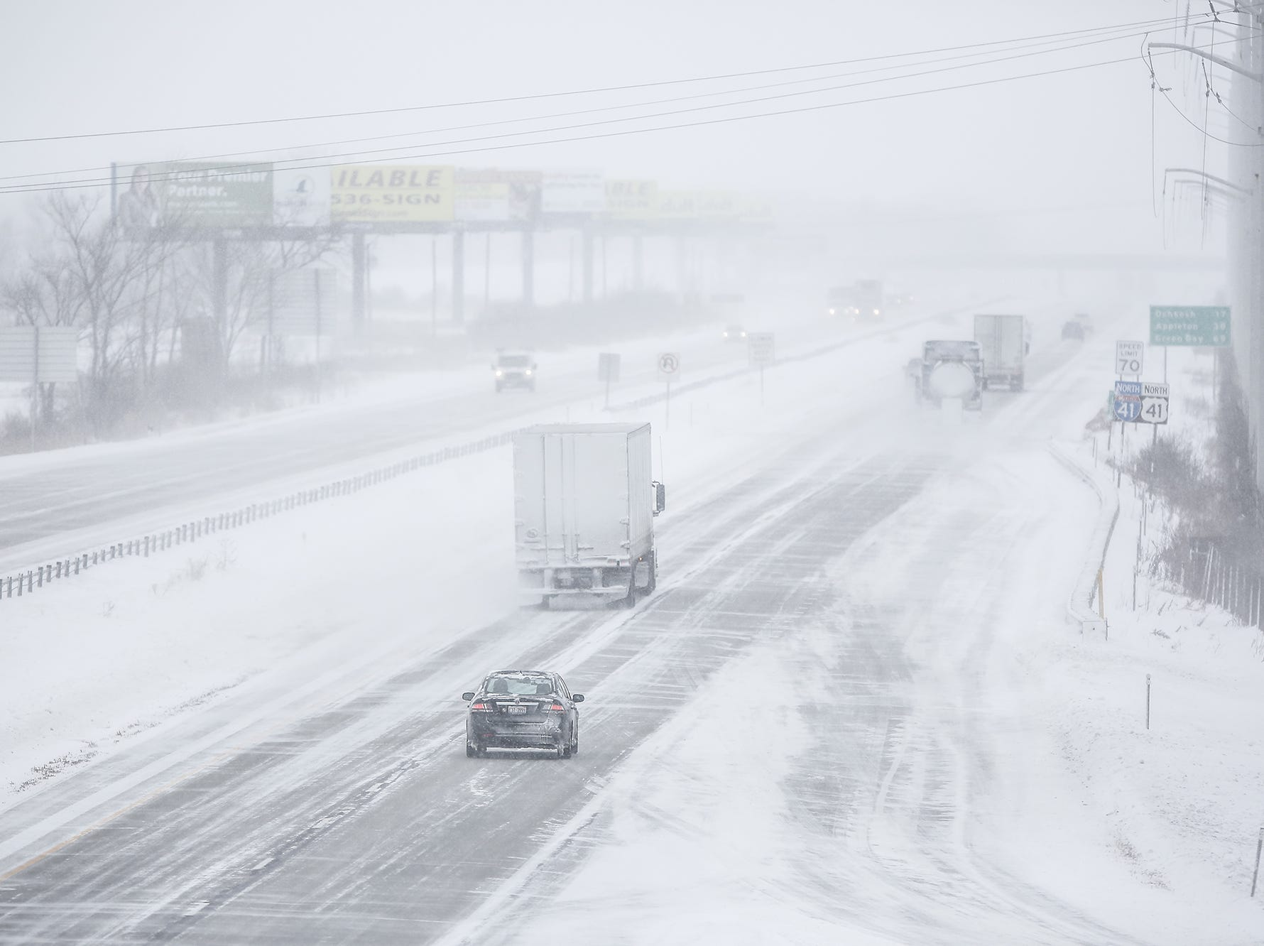 Cars and trucks travel on a snow covered I-41 Monday, Jan. 28, 2019, in Fond du Lac County during a snow storm that hampered travel and closed businesses and schools in the Fond du Lac area. This was the Fond du Lac area's second snow storm in five days.