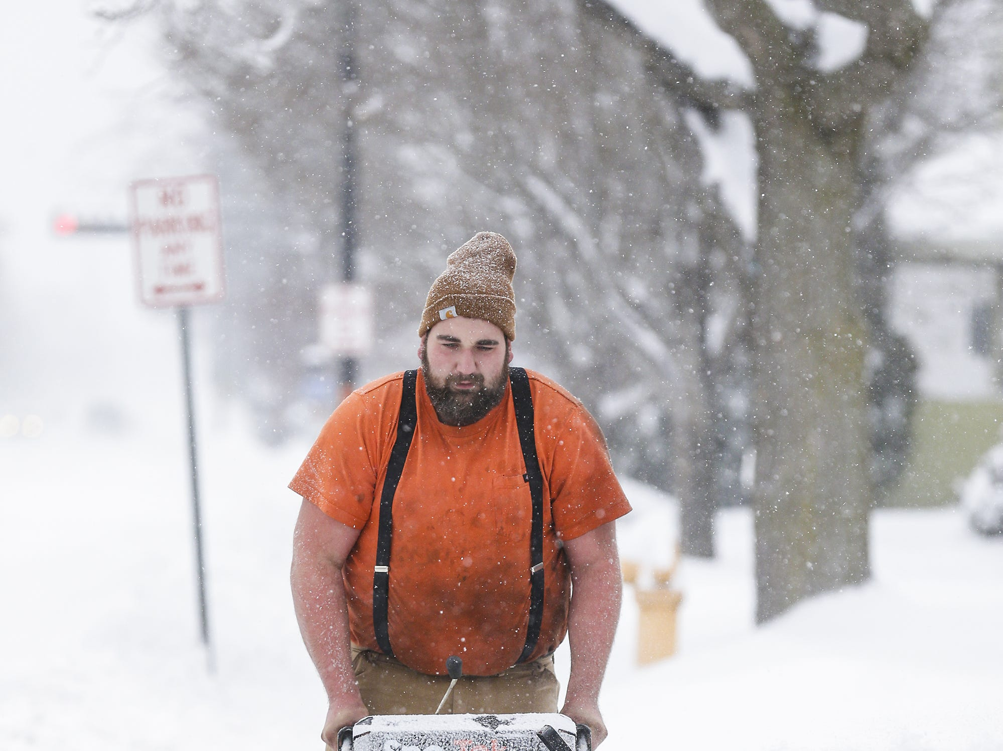 Jacob Schwefel of Fond du Lac snow blows the sidewalk in front of his Johnson Street home Monday, Jan. 28, 2019, during a snow storm that hampered travel and closed businesses and schools in the Fond du Lac area. This was the Fond du Lac areas second snow storm in five days.