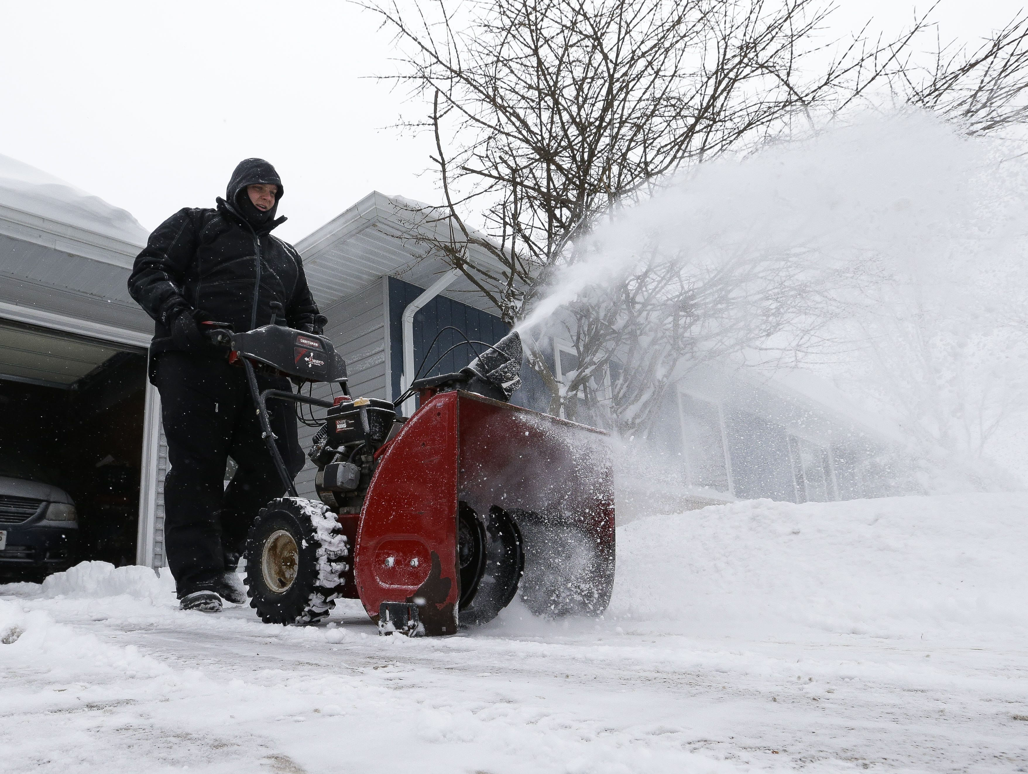 Jake Mortimer clears his driveway on Monday, Jan. 28, 2019, in Stevens Point, Wis. A winter storm rolled through Wisconsin on Sunday and Monday, marking the first major snowfall of the season.
