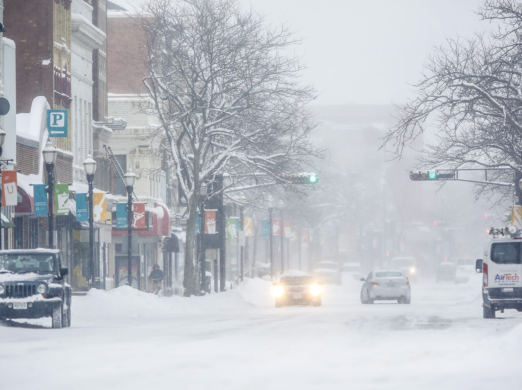 Downtown Fond du Lac, Wisconsin was snow-covered and slippery Monday, Jan. 28, 2019, during a snow storm that hampered travel and closed businesses and schools in the Fond du Lac area. This was the Fond du Lac area's second snow storm in five days.
