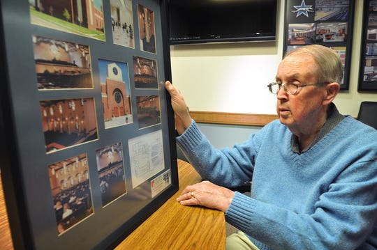 Retired architect Charles Harper looks over photos of the First United Methodist Church of Coppell, Texas in this 2014 file photo. Harper designed plans for hundreds of buildings, renovations and restorations around Wichita Falls and developed a specialty for designing structures that would survive major storms and tornadoes. He worked on more than 1,850 projects in his 50-year career.
