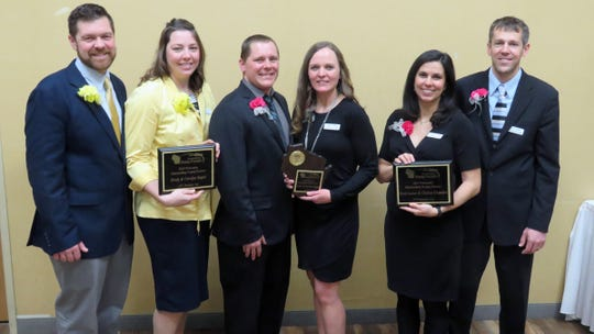 Pictured are the top three winners in the 2019 Wisconsin Outstanding Young Farmer award. From left are Brody and Carolyn Stapel, first runner up; Adam and Chrissy Seibel, winners; and Chelsea Chandler and Scott Laeser, second runner up.
