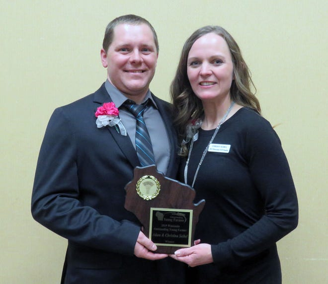 Adam and Chrissy Seibel are the winners of the 2019 Wisconsin Outstanding Young Farmer award. The Seibel's farm was one of the first organic farms in the country to put in robotic milkers.